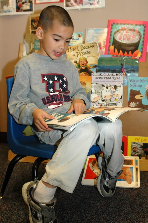 """Manuel Visocsky, 5, reads a book in the Travis Head Start """"library."""" (U.S. Air Force photo by Staff Sgt. Raymond Hoy)"""