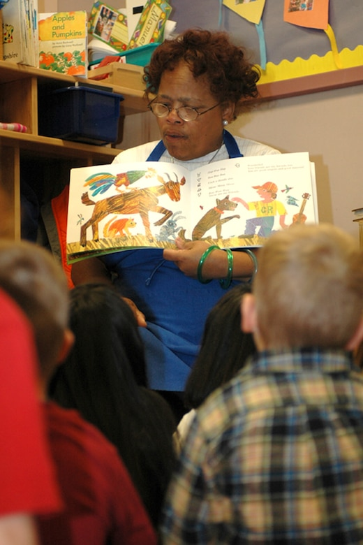 Mrs. Dorothea Wolfe, head teacher of the morning class, reads to the children during storytime. (U.S. Air Force photo by Staff Sgt. Raymond Hoy)