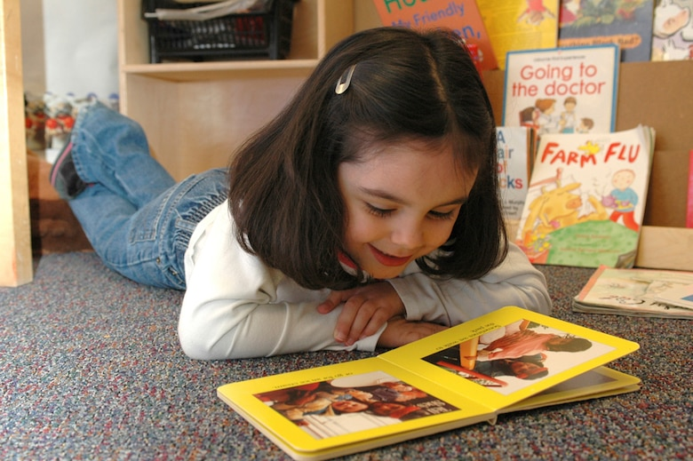 Sydney Walker, 4, says she likes it best when the parents come in to the class to read. (U.S. Air Force photo by Staff Sgt. Raymond Hoy)