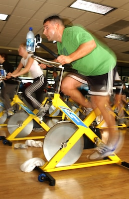 Anthony Sibilia gets a workout during the cycle segment of the aerobathon. The event officially ended the S.M.A.R.T. Goals fitness incentive program, a three-month program where participants set and attempted to accomplish fitness goals within that timeline. (U.S. Air Force photo by Nan Wylie)