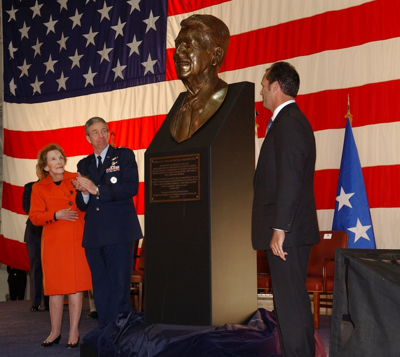 "Former First Lady Nancy Reagan, Lt. Gen Henry A. ""Trey"" Obering III and Riki Ellison admire a bust of the 40th president unveiled at the Ronald W. Reagan Missile Defense Site dedication ceremony at Vandenberg Air Force Base, Calif., on Monday, April 10, 2006. General Obering is the Air Force director of the Missile Defense Agency and Mr. Ellison is the founder of the Missile Defense Advocacy Alliance. (U.S. Air Force photo/Tech. Sgt. Scott Seyer)"