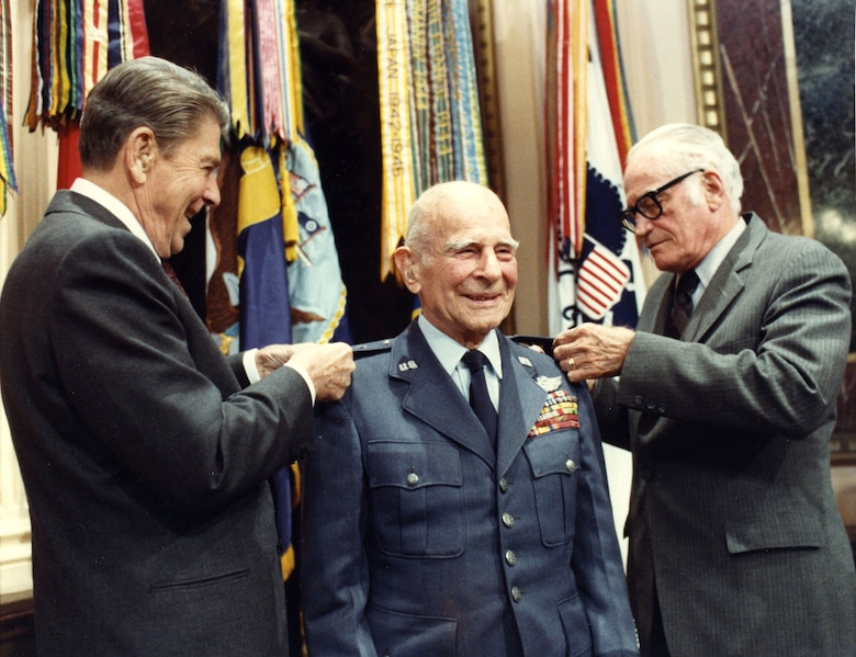 President Ronald Reagan and Senator Barry L. Goldwater pin the fourth star on Gen. James Doolittle April 10, 1985, 26 years after his retirement from the U.S. Air Force. General Doolittle was advanced to four-star rank by Senate confirmation, making him the first person in Air Force Reserve history to wear four stars.  (White House photo by Bill Fitz-Patrick)