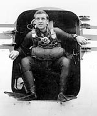Airman 1st Class William H. Pitsenbarger in the doorway of an aircraft.