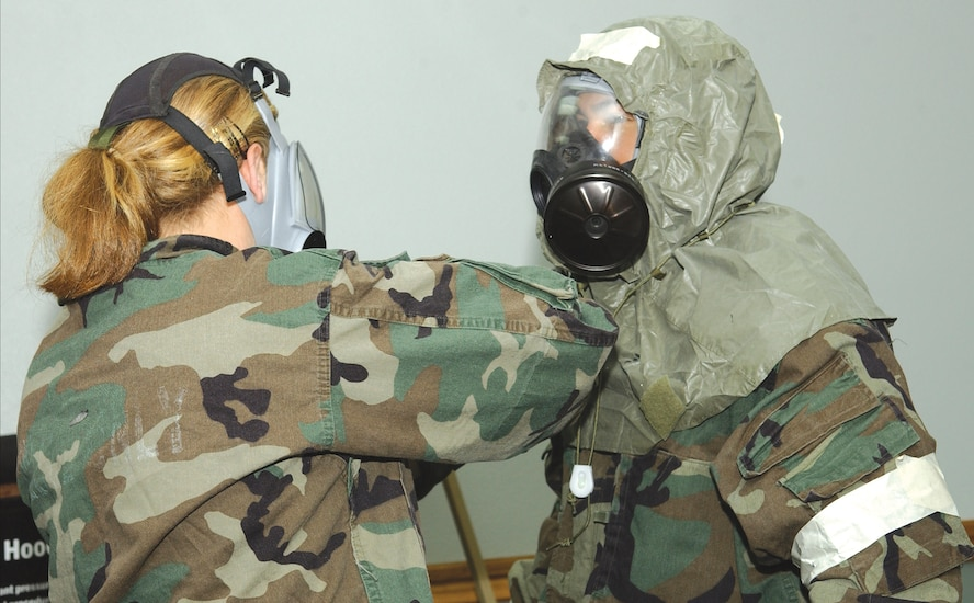 CANNON AIR FORCE BASE, N.M. -- At the Chemical, Biological, Radiological and Nuclear Defense training, Airmen practiced doning their Mission Oriented Protective Posture gear. (U.S. Air Force photo by Staff Sgt. April Wickes)