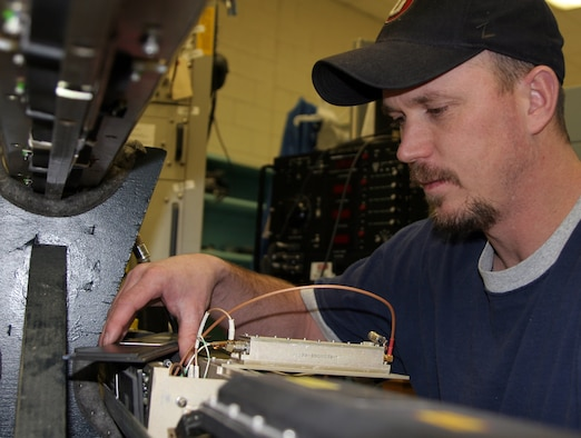 HILL AIR FORCE BASE, Utah  - Shane Wright, an integrated electronic equipment repairer for the 309th Electronic Maintenance Group here, assesses a P4B mockup pod for power amp testing.  (Air Force photo by G. A. Volb)