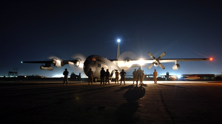 Maintainers at Bagram Air Base, Afghanistan, stand by as the aircrew starts the engines on an EC-130H Compass Call's. The aircraft is assigned to the 41st Expeditionary Electronic Combat Squadron. The Compass Call is an airborne tactical weapon system used to deny, degrade and disrupt the enemy's ability to communicate.  Since April 2004, 41st EECS EC-130s have flown more than 700 combat sorties supporting ground forces in Operation Enduring Freedom.  (U.S. Air Force photo/Capt. James H. Cunningham)