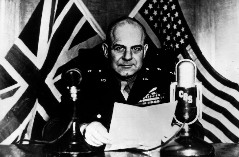 Lt. Gen. James H. Doolittle, commander of Army Air Forces Eighth Air Force, speaks on a British radio program observing the launch of the U.S. aircraft carrier USS Shangri-La. General Doolittle reported that the 8th AF knocked out more than 1,500 German fighter planes and dropped more than 24,000 tons of bombs on Germany in April, 1944. (U.S. Air Force photo)