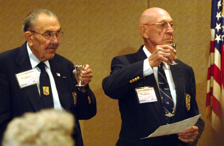 Doolittle Raiders, retired Lt. Col. Dick Cole (right) and retired Lt. Col. Chase Nielsen, raise their goblets to toast their fellow Raiders at the group's 64th reunion in Dayton, Ohio, on Tuesday, April 18, 2006. (U.S. Air Force photo/Tech. Sgt. Cecilio M. Ricardo Jr.)
