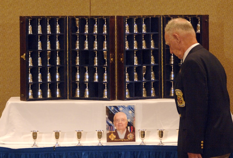 Retired Master Sgt. Ed Horton honors the memory of retired Lt. Col. Horrace Crouch by turning his goblet upside down at the goblet ceremony during the 64th Doolittle Raider reunion in Dayton, Ohio, on Tuesday, April 18, 2006. The goblet ceremony is held to honor the Raiders who died since their last meeting. This year, they honored Colonel Crouch, who passed away Dec. 21 from pneumonia. (U.S. Air Force photo/Tech. Sgt. Cecilio M. Ricardo Jr.)