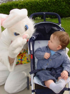 Cole Listello, 1, son of Capt. (Dr.) Trent Listello, 60th Dental Squadron oral surgeon, and Katrina Listello gets a surprise visit by the Easter Bunny during an egg hunt held on the grounds of the Travis Fisher House April 14. (U.S. Air Force photo by Jim Spellman)