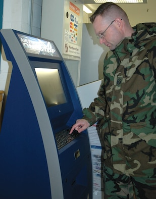 Master Sgt. Christopher Kozel, 91st Operations Group, uses the Air Force OneStop kiosk located inside the Shoppette for the first time Tuesday. (U.S. Air Force photo by Senior Airman Danny Monahan)