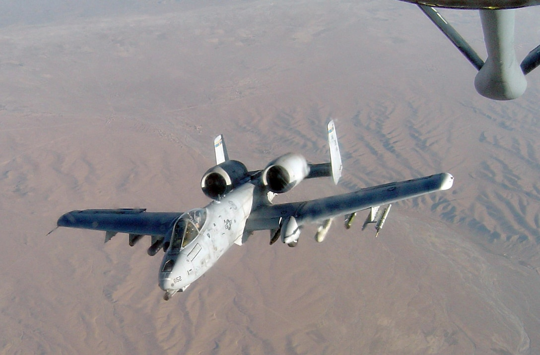 An A-10 Thunderbolt II carrying a Fighter Aircraft Communication Enhancement pod prepares to refuel in the skies over Bagram, Afghanistan. The pod enables ground units to relay their coordinates to patrolling aircraft, allowing them to engage the enemy as needed. (Courtesy Photo)