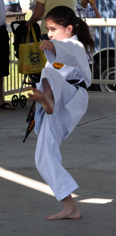 Alina Burroughs, daughter of Master Sgt. Richard Burroughs, demonstrates karate forms under the pavillion during Saturday's Family Fest.
