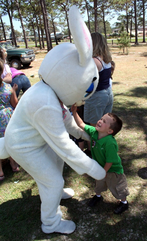 Dominique Colon, son of Staff Sgt. Rachel and Victor Colon, greets the Easter Bunny at the egg hunt and Family Fest Saturday morning in the community park. Airman 1st Class Megan Stanton, 16th Medical Support Squadron, spent the day inside the bunny suit.