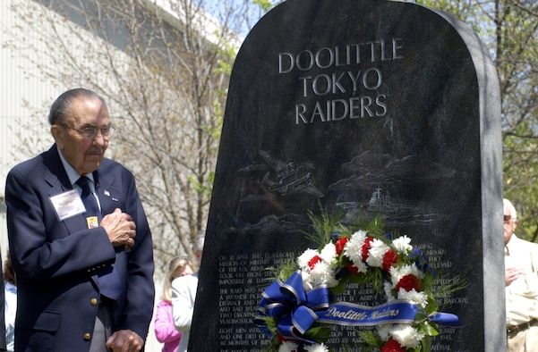 DAYTON, Ohio - Retired Lt. Col. Chase Nielsen stands for the playing of taps after a wreath was placed by the Doolittle Tokyo Raiders memorial at the National Museum of the U. S. Air Force April 18, 2006. The ceremony was held to recognize the achievements of the Raiders on the 64th anniversary of the mission over Tokyo, Japan. (Air Force photo by Spencer Lane)