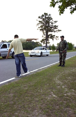 Staff Sgt. Xavier Daniel practices giving a field sobriety test at Moody Air Force Base, Ga., Monday, April 17, 2006. He is assigned to the 347th Security Forces Squadron. (U.S. Air Force photo/Airman Elizabeth Rissmiller)
