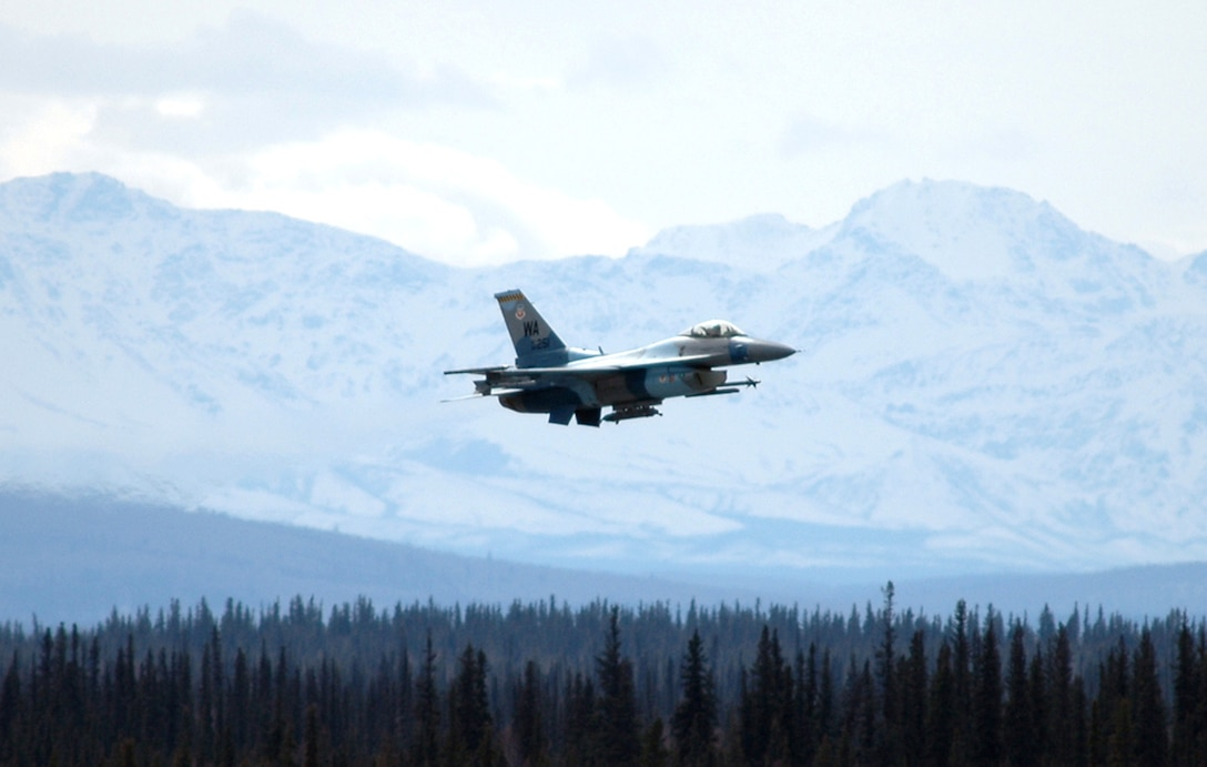 "An ""enemy"" F-16 Fighting Falcon from the 64th Aggressor Squadron, Nellis Air Force Base, Nev., takes off from Eielson AFB, Alaska, during Red Flag-Alaska 06-2. The unit is playing the ""hostile"" force in the wargame scenarios. (U.S. Air Force photo/Tech. Sgt. Jeff Walston)"