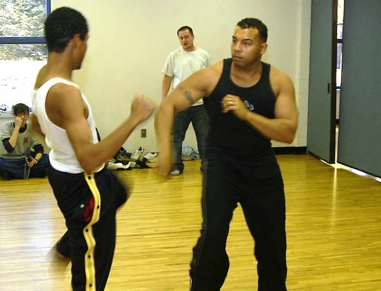 Staff Sgt. Dave Armstrong, right, spars with Santiago, 18, at a local community center in Colorado Springs, Colo., on Tuesday, April 11, 2006. Sergeant Armstrong, known to his students as Sensei Dave, teaches martial-arts classes for at-risk teens. Sergeant Armstrong is an information manager with Detachment 2 of the 17th Test Squadron at Cheyenne Mountain Air Force Station, Colo. (U.S. Air Force photo/Staff Sgt. Don Branum)