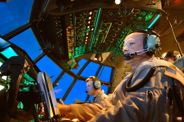 Maj. Mike Steigerwald (right) and Capt. Brady Ohr view the control panel on their C-130 Hercules and surrounding airspace during a combat support flight over Southwest Asia on Wednesday, April 19, 2006. The reservists are deployed to the 746th Expeditionary Airlift Squadron from the 327th Airlift Squadron at Willow Grove Air Reserve Station, Pa. (U.S. Air Force photo/Master Sgt. Lance Cheung)