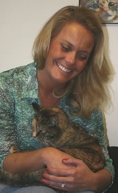 CANNON AIR FORCE BASE, N.M. - Jane West, wife of Col. Scott West, 27th Fighter Wing commander, an avid pet lover,  holds one of the cats living at Sundance Ranch. Sundance receives cats from a variety of places. During last year's hurricanes, they received more than 30 to care for at the ranch. (U.S. Air Force photo by Janet Taylor-Birkey)