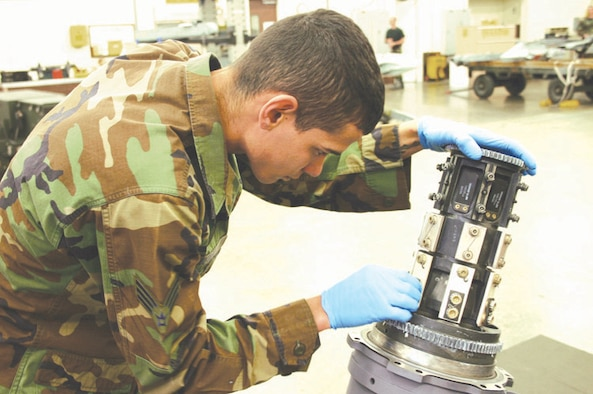 CANNON AIR FORCE BASE, N.M. - Senior Airman Wilfredo Nieves inspects the safety wires of the main gun system on a M61A1 20mm gun. Airman Nieves is part of the Armament Shop for the 27th Equipment Maintenance Squadron that has embarked on a new initiative to eliminate three days of aircraft downtime for each aircraft maintenance unit. (U.S. Air Force photo by Airman Thomas Trower)