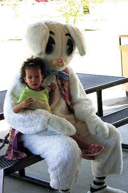 CANNON AIR FORCE BASE, N.M. - Kyana Burney, age 22 months, sits with the Easter Bunny during the 27th Medical Group's annual Easter egg hunt April 14 at Unity Park. Families of the 27th Medical Group were invited out from 11 a.m. to 1 p.m. for a variety of Easter related activities. (U.S. Air Force photo by Staff Sgt. Craig Seals)