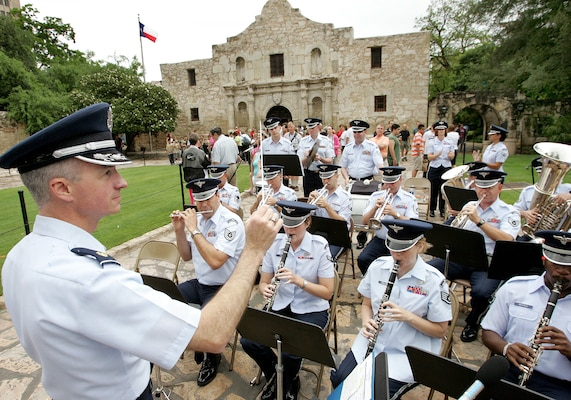 Maj. Dean Zarmbinski conducts the Air Force Band of the West in front of the Alamo during the opening ceremony of Fiesta, a 10-day celebration in San Antonio, on Friday, April 21, 2006.  Major Zarmbinski is the band commander.  (U.S. Air Force photo/Robbin Cresswell)