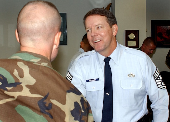 Chief Master Sgt. of the Air Force Rodney J. McKinley greets Master Sgt. Michael Owen, 21st Security Force Squadron first sergeant, while visiting the Airman Leadership School at Peterson Air Force Base, Colo. The chief visited the schoolhouse and Headquarters Air Force Space Command July 28. (U.S. Air Force photo/Tech. Sgt. Raheem Moore)