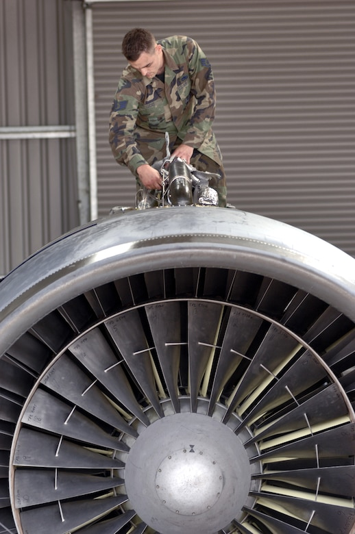 Staff Sgt. Erik Lucas checks components atop a C-5 Galaxy turbofan engine at Royal Air Force Mildenhall, England, on July 31. The sergeant is an engine manger with the 727th Air Mobility Squadron and responsible for the spare turbofan engine kept for the giant transport aircraft. Each engine produces 43,000 pounds thrust, weighs 7,900 pounds and is nearly 27 feet long. (U.S. Air Force photo/Master Sgt. Lance Cheung)