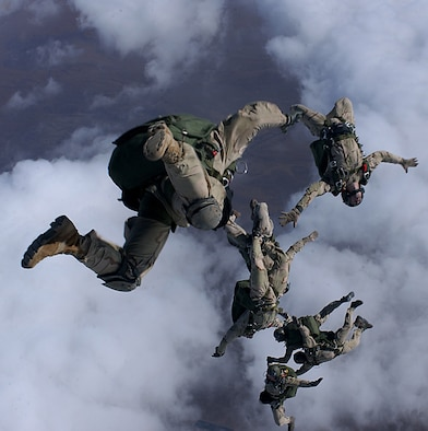 Pararescue men from the 38th Rescue Squadron, Moody AFB, GA and the 58th Rescue Squadron, Nellis AFB, NV jump from a C-130 for a High Altitude Low Opening (HALO) free fall drop from 12999 feet in support of Operation Enduring Freedom. PJs use a variety of jumps depending on the mission.  (U.S. Air Force Photograph by Staff Sgt. Jeremy T. Lock)