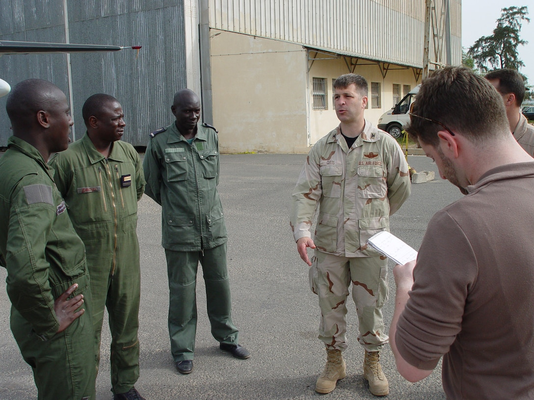 Col. Brian Cutts, right, 352nd Special Operations Group deputy commander, discusses aircraft and local capabilities of the Senegalese Air Force, with Senegalese Air Force officers at Dakar International Airport June 12.  (U.S. Air Force photo by Master Sgt. Dennis Brewer)