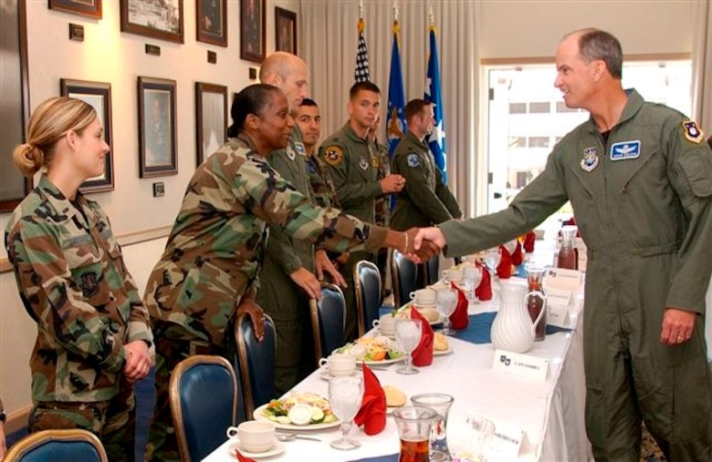 Capt. Alida Forbes, 4th Space Launch Squadron, shakes hands with Gen. Kevin P. Chilton, commander, Air Force Space Command, during a company grade officer luncheon at Vandenberg Air Force Base, Calif., July 20. (Air Force photo by Staff Sgt. Samuel Bendet)