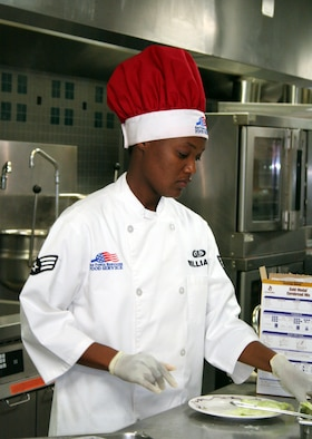 Senior Airman Vanessa Williams, 16th Services Squadron, prepares her plate during the first Chef of the Quarter competition held in two years.