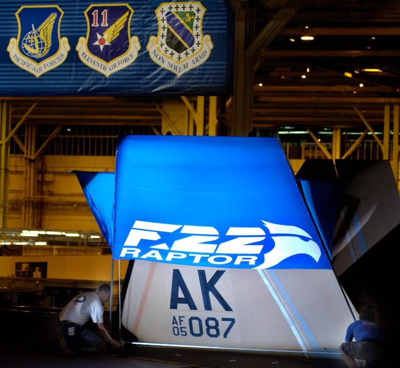 The tail section of an F-22 Raptor being assigned to Pacific Air Forces is prepared for an unveiling ceremony Aug 3 at the Lockheed Plant in Marietta, Ga.  The aircraft, which is still under construction, will be the first of 36 F-22s assigned to Elmendorf Air Force Base, Alaska, beginning next year.  (Courtesy photo/John Rossino)