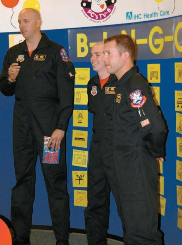(Left to right) Staff Sgt. William Griffith, SeniorAirmen Mark Vandevender and Kenneth Umeck,with the Viper West demo team, speak to 150 kidsvia a television link during a Bingo game March 15at Primary Children?s Medical Center.
