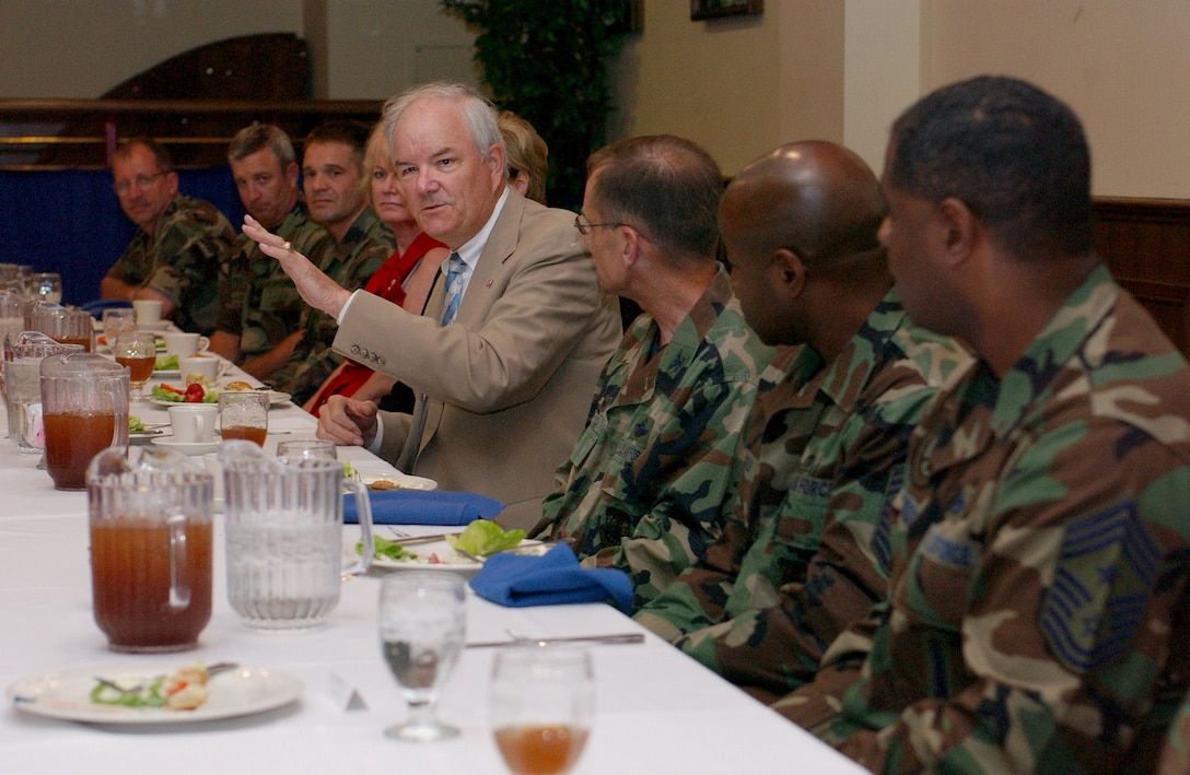 Secretary of the Air Force Michael W. Wynne speaks with chief master sergeants and first sergeants during lunch at the Galaxy Club July 18 during his visit to RAF Mildenhall, England.  It was the secretary's first visit to the base since assuming his post in 2005. While here, Secretary Wynne had the opportunity to learn about base-level issues and interface directly with Airmen.  (U.S. Air Force photo by Tech Sgt. Jeanette Copeland)