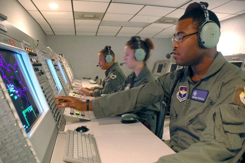 First Lts. Andrew Popoola, Renee Powell and Darin Romain practice sending free text messages at Tyndall Air Force Base, Fla., to F-22 Raptor pilots on July 27. The 325th Air Control Squadron trains all active duty, Guard and Reserve undergraduate air battle managers. The lieutenants are all air battle manager students. (U.S. Air Force photo/1st Lt. Jon Quinlan)