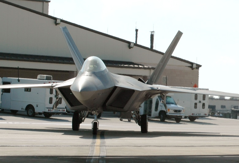 An F-22 Raptor taxis to the hangar after a mission at Tyndall Air Force Base, Fla. Command and control integration advancements with the Raptor include free text messages which can be sent by controllers to the pilots using high-speed digital data link technology. (U.S. Air Force photo/1st Lt. Jon Quinlan)