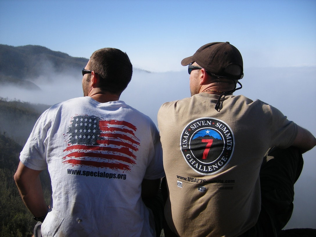 1st Lt. Mark Uberuaga, left, and Capt. Rob Marshall gaze upwards toward the summit of Mount Kilimanjaro during a break on day two of their ascent. The two were part of an Air Force team which scaled the African peak July 16.  (U.S. Air Force photo by Capt. Nichelle Brokering)