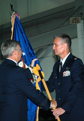 Maj. Gen. Richard C. Collins (left), 10th Air Force commander, passes the 919th Special Operations Wing flag to Col. Steven J. Chapman at an assumption of command ceremony at Duke Field, Fla., Aug. 6. The 919th SOW is a subordinate of 10th Air Force headquartered at Naval Air Station Fort Worth Joint Reserve Base, Texas, and the Air Force Reserve Command, Robins Air Force Base, Ga. In wartime or contingency, the 919th SOW reports to Air Force Special Operations Command at Hurlburt Field, Fla., its gaining command. (U.S. Air Force photo/Senior Airman Erik Hofmeyer)
