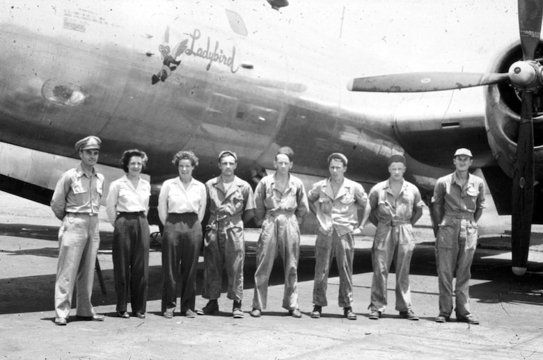 "Dora Dougherty, third from left in front of B-29 ""Ladybird"" with Lt. Col. Paul W. Tibbets, Jr. (left), Dorothea Johnson (2nd from left) and B-29 crew. (U.S. Air Force photo)"