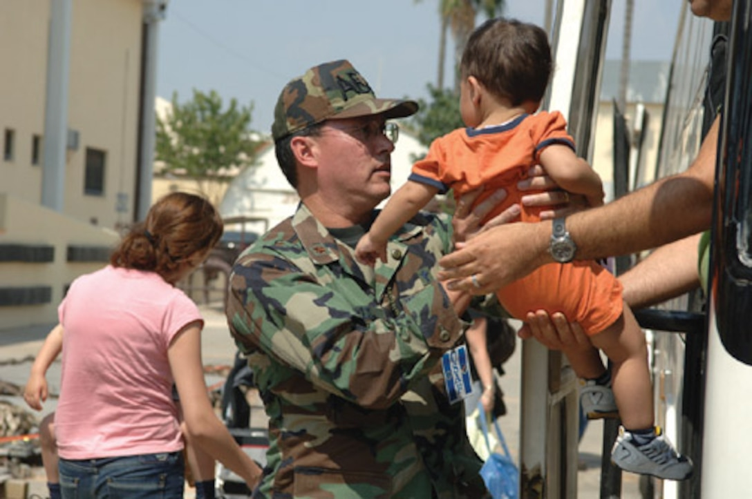 Chaplain (Maj.) Kenneth Reyes,39th Air Base Wing senior chaplain, helps unload displaced American citizen's from Lebanon Monday. Incirlik received more than 1,700 departing American's July 22.