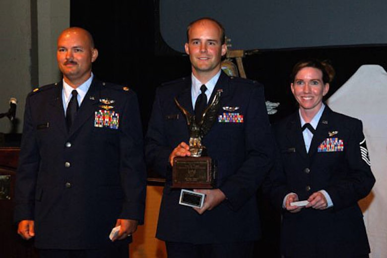 Maj. Larry Brown, 1st Lt. Austin Aggson and Master Sgt. Tonya Halenka received the 2005 AFA award; Maj. Byron Rager was unable to attend due to being deployed.