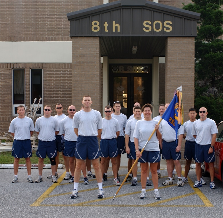 Members of the 8th Special Operations Squadron stand in front of their squadron at Duke Field, Fla., before participating in a 26-mile relay run from Duke Field to Hurlburt Field Aug 9. The run kicked off the start of the 8th SOS deactivation festivities prior to the official ceremony.  (U.S. Air Force photograph by Senior Airman Andy Kin)