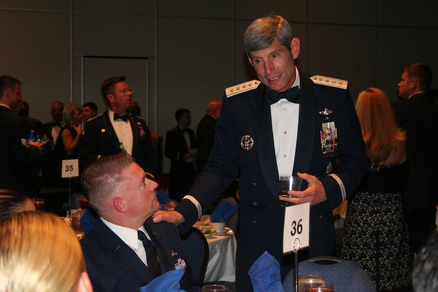 Gen. Norton Schwartz, U.S. Transportation Command commander, chats with members of the 8th Special Operations Squadron during social hour of the active-duty Combat Talon farewell dinner Aug. 9.  (U.S. Air Force photograph by Staff Sgt. Mareshah Haynes)