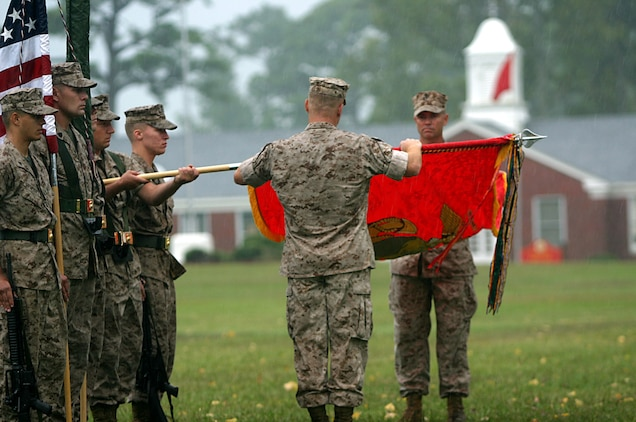 MARINE CORPS BASE CAMP LEJEUNE, N. C. ? (July 11, 2006)-- Lt.Col. Paul D. Montanus and Sgt. Maj. Richard W. Ashton fold the colors of 2nd Force Reconnaissance Battalion during a rainy ceremony here Friday. Second Force  deactivated and 2nd Marine Special Operation Battalion  activated in its place in support of Marine Corps Forces Special Operations Command. (Official U.S. Marine Corps Photo by Cpl. Ken Melton)