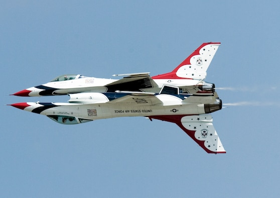 Thunderbirds No. 5 and 6 perform a reflection pass during a practice show at Scott Air Force Base, Ill., on Aug. 11. (U.S. Air Force photo/Master Sgt. Jack Braden)