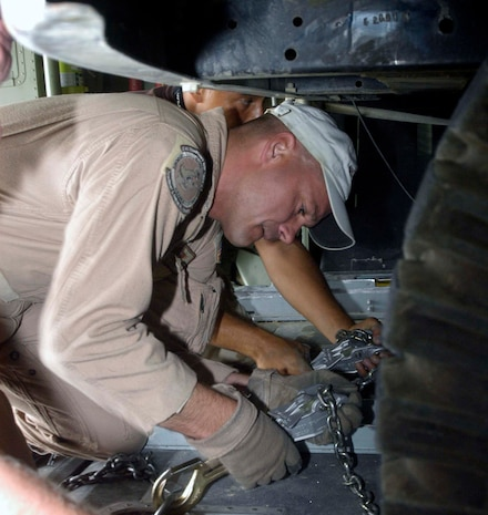 Master Sgt. Jeff Springsteen secures a four-wheel drive vehicle in the back of a C-130 Hercules cargo plane in Kabul, Afghanistan, Aug. 10.  Sergeant Springsteen is a C-130 loadmaster from the Delaware Air National Guard's 142nd Airlift Squadron, currently deployed to the 774th Expeditionary Airlift Squadron at Bagram Airfield, Afghanistan.  C-130s provide the bulk of the airlift and airdrop to re-supply U.S. and Coalition forces throughout Afghanistan.  The 774th EAS is manned by Air Guardsmen from Delaware, Alaska, Tennessee, Texas, Nevada, Wyoming, Arkansas and Puerto Rico.  (US Air Force photo/Maj. David Kurle)