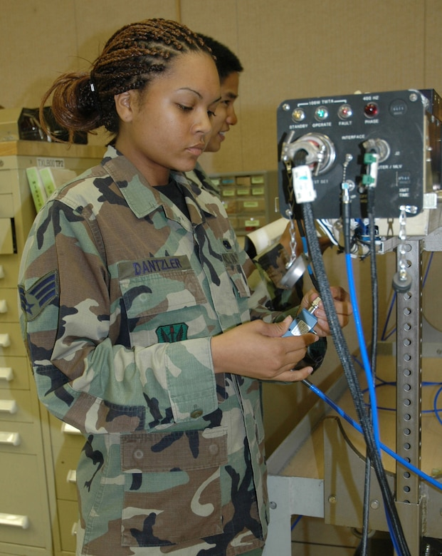 TYNDALL AIR FORCE BASE, Fla. (AETCNS) -- Senior Airman Jennifer Dantzler, 28th Test Squadron/Detachment 2 electronic warfare technician, hooks up wires to an electronic warfare defense pod used on Air Force fighter jets. The squadron, one of Tyndall's tenant units, won the Air Force Association's 2006 Theodore Von Karman Award for outstanding contributions to national defense in the field of science and engineering related to aerospace activities. Electronic warfare systems and its associated capabilities are part of more than 400 test missions in support of 17 programs accomplished in 2006 across the combat Air Forces. Specifically, the pod in the picture is an essential tool for testing and training on F-15 and F-16 aircraft radar and avionics suites. (U.S. Air Force photo by Chrissy Cuttita)