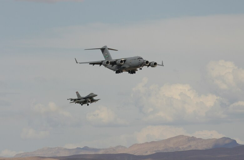 A C-17 from McChord AFB, Wash., and an F-16CJ from Cannon AFB, N.M., come in to land on the parallel runways at Nellis AFB, Nev., Aug. 14 during Red Flag. The exercise, which ends Sept. 2, puts up to 80 aircraft in the air at one time to train crews in large-force operations in a highly realistic combat environment. (Photo courtesy Paul Ridgway)